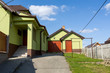 Detalii fotografie repaired rural house fixed facade insulation and painted to green  color
