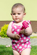 Dettagli della fotografia happy cute little one year old girl outdoor summer with pink dress