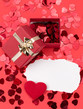 Detalii fotografie small red hearts confetti and present box with white text space