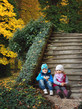 Detalii fotografie children sitting on old stone stairs in the park