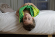 Detalii fotografie Boy child kid lying on a bed