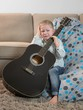 Detalii fotografie little boy with a guitar and crying