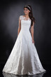 Detalii fotografie young beautiful woman in a wedding dress on a studio background