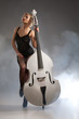 Image details young woman in a black underwear with a double bass