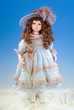Detalii fotografie the big doll on a blue and white background