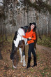 Detalii fotografie young woman and horse in a forest