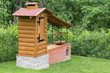 Detalii fotografie small homemade smokehouse with stone base and long inlet flue