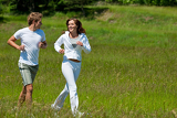 Fotografia Young couple jogging outdoors in spring nature