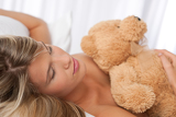 White lounge - beautiful woman holding teddy bear