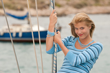 Blond young woman on sailing boat
