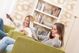 Students - Two female student relaxing home