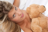 White lounge - Portrait of beautiful woman holding teddy bear