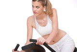 Fitness series - Young woman with exercise bike