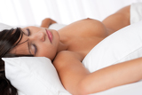 Brown hair woman sleeping naked in white bed