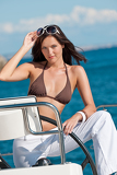 Young woman sailing on luxury yacht