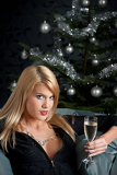 Portrait of blond sexy woman with glass of champagne