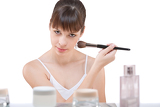 Fotografie Body care: Young woman applying powder with brush