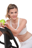 Fotografie Fitness series - Woman holding apple