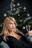 Portrait of blond sexy woman with champagne on Christmas