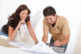 Man and woman at architect office working