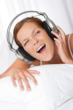 Young woman in white with headphones