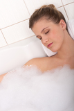 Body care series - Woman lying in the bathtub