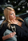 Fotografie Portrait of blond sexy woman with champagne on Christmas