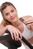 Fotografie Fitness series - Woman holding piece of chocolate