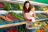 Grocery store shopping - Smiling woman with vegetable