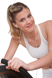 Fotografie Fitness series - Woman with headphones exercising
