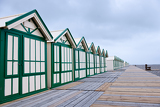 Long row of wooden beach cabins