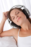 Woman with closed eyes enjoying music