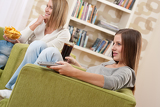 Students - Two female teenager watching television