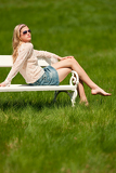 Spring and summer - Young woman relaxing in meadow