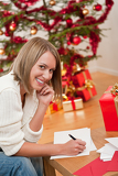 Attractive blond woman writing Christmas cards