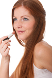 Body care series - Beautiful young woman applying lipstick