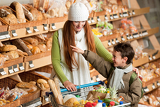 Grocery store shopping - Long red hair woman with child