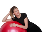 Fotografie Fitness - Young woman with exercise ball on white
