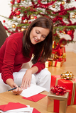 Attractive brunette writing Christmas cards