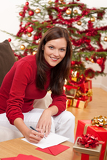 Fotografie Attractive brunette writing Christmas cards