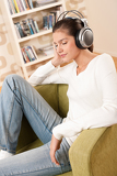 Students - Happy female teenager with headphones
