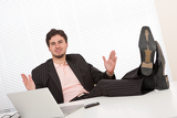 Fotografie Successful businessman gesturing at office