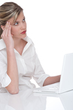 Blond attractive woman working with laptop