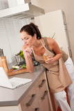 Woman with laptop in the kitchen