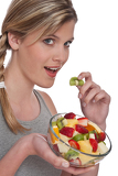 Healthy lifestyle series - Woman with fruit salad