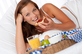 Young woman having home made breakfast