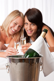 Fotografie Two young women toasting with champagne