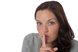 Brown hair woman with  with finger on lips