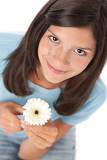 Happy teenager with gerber daisy