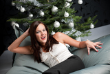 Fotografie Provocative sexy woman posing in front of Christmas tree